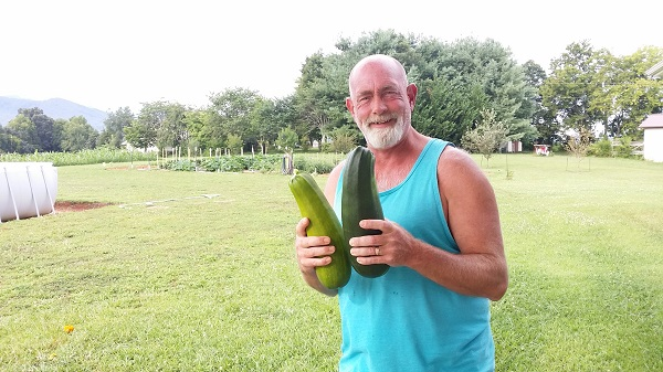 hubby with big zucchini