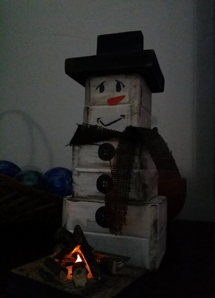 wood snowman and wood firepit
