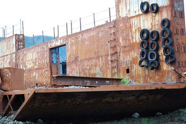 rusty barge with tires